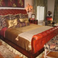 leather bed frame and gold bed spread