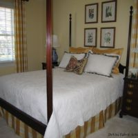yellow buffalo check curtains and white bedspread