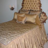 Antique headboard, bedspread with gathered skirt