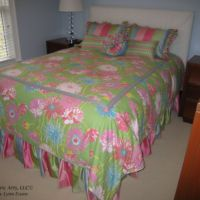 floral bed spread with rose pillow