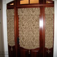 Hobbled Roman Shades with Shaped Hem on Door and Sidelights
